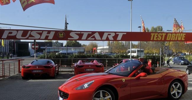 Ferrari hometown overwhelmed by roar of test-driving fans