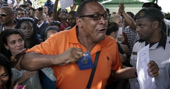 Hundreds gather in Cuba in frustration at Ecuador visa rule