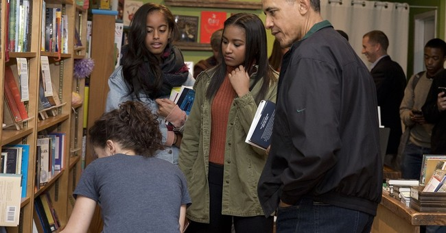 Obama shops at Washington bookstore, popular frozen pop shop