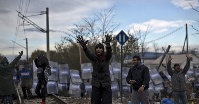 The Latest: Macedonia: 18 officers injured in migrants clash