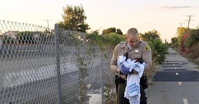 Sheriff's deputies rescue newborn found buried near river