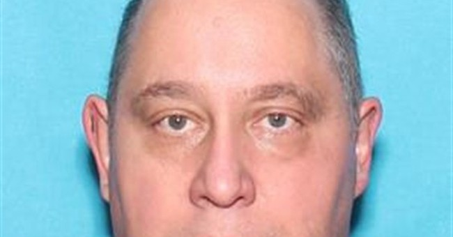 Police officer shot, killed during call; suspect charged