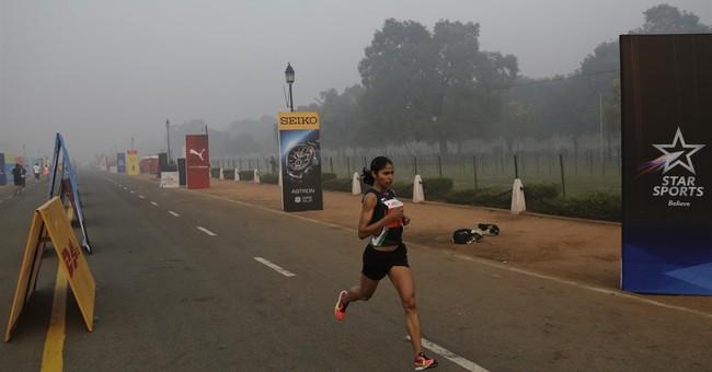 Tens of thousands overcome Delhi pollution in half marathon