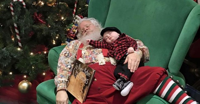 Santa obliges dad of sleeping boy with snoozing photo