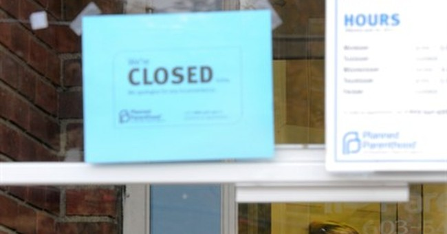Planned Parenthood clinic damaged in hatchet attack reopens