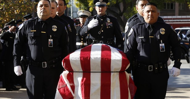 Hundreds pay respects to slain California police officer