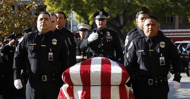 Hundreds pay respects to slain California police officer