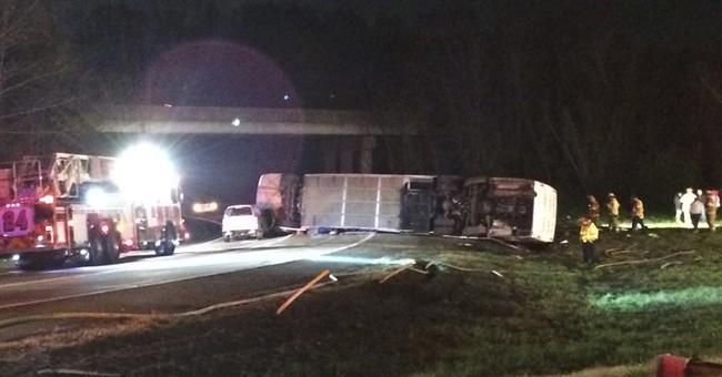 Bus overturns; 1 seriously hurt, dozens of minor injuries