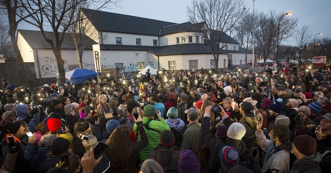 The Latest: Man who allegedly shot at protesters charged