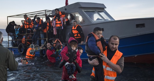 Italy urges quicker refugee relocations across Europe