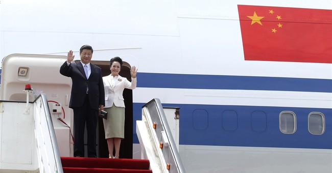 Chinese leader Xi Jinping welcomed in cash-strapped Zimbabwe