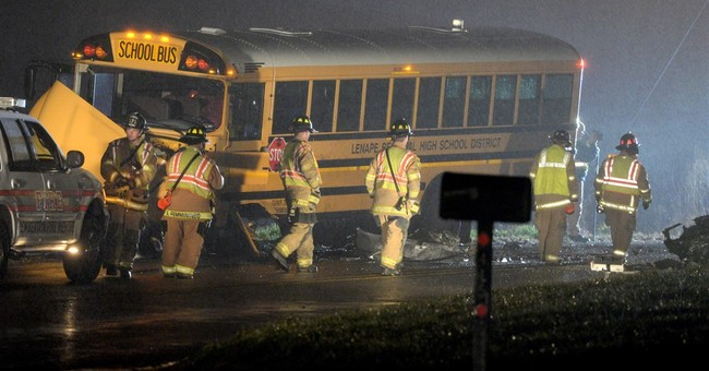 2 die in car that crashes with school bus carrying swim team