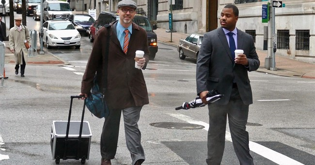 The Latest: Defense says officer thought Gray was faking