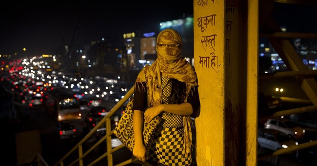 AP Photos: As air quality drops Delhi fashions its own masks