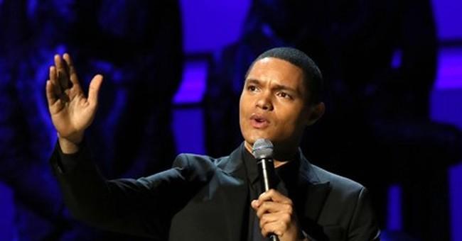 Bono, Biden, Cyrus celebrate fight against AIDS at concert
