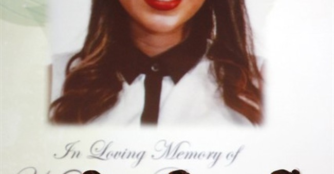 Mourners remember US student killed in Paris attacks