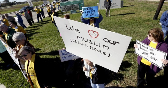 The Latest: Texas church holds rally in support of mosque