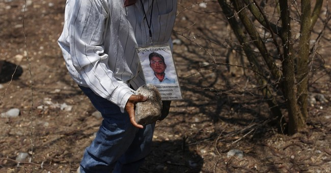 Mexicans search for remains of loved ones in countryside