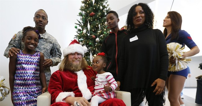 Jets honor 18 military families with holiday party