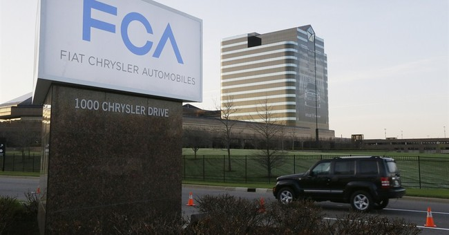 Fiat Chrysler US 2014 profit falls 56 pct. on one-time items