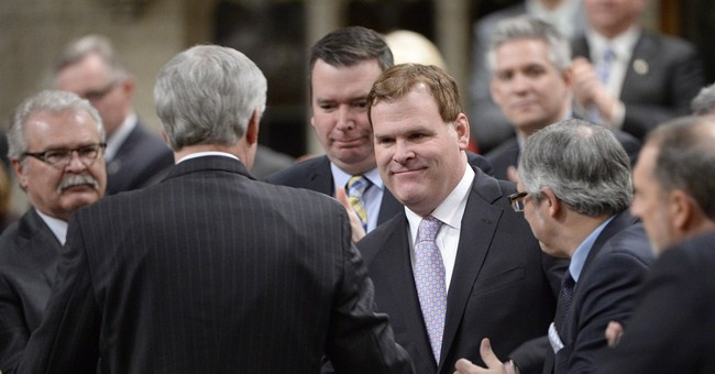 Canadian Foreign Minister John Baird resigns unexpectedly