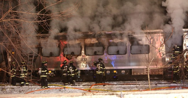 Commuter train smashes into SUV on tracks, killing 7 people