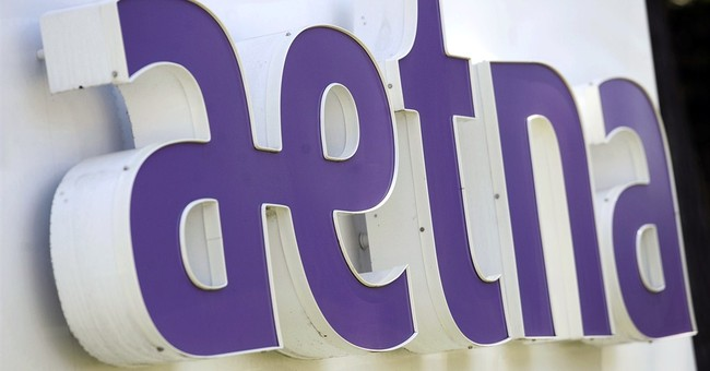 Aetna 4Q profit drops but meets forecasts, guidance climbs