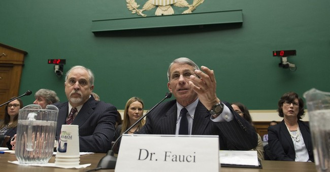 Federal health officials face tough questions on flu vaccine