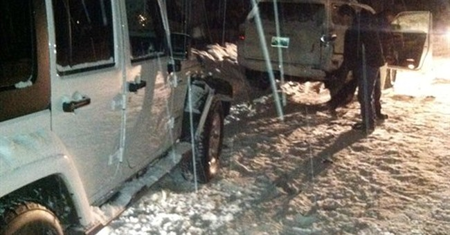 Lance Armstrong cited after parked cars hit by SUV