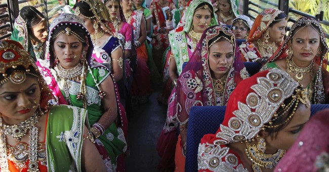 AP PHOTOS: Indian businessman hosts wedding for 151 couples