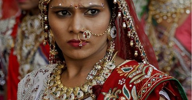 AP PHOTOS: Indian businessman hosts wedding for 151 couples