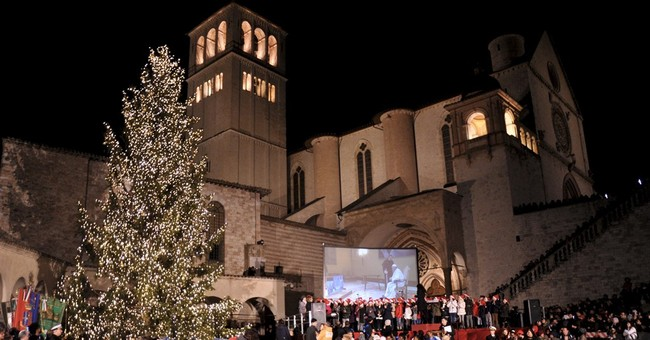 Pope symbolically lights Assisi Christmas tree for migrants