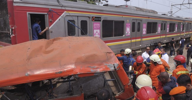 Commuter train hits passenger bus in Indonesia; 18 dead