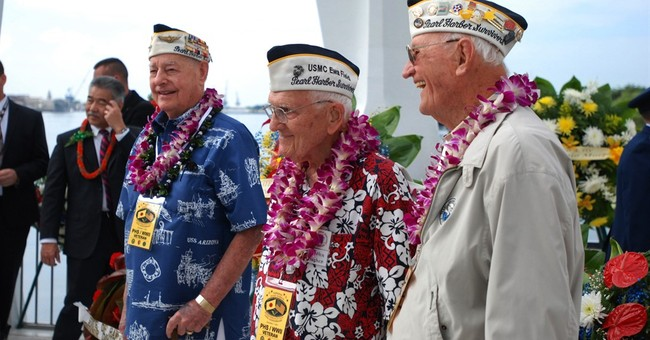 The Latest: Pearl Harbor survivor returns to greet shipmates