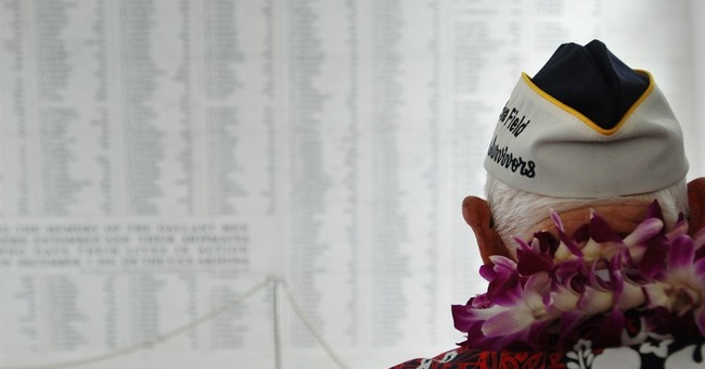 The Latest: Pearl Harbor survivor returns to greet shipmates