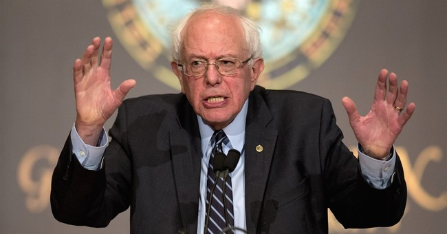 Sanders unveils climate change plan, rails against polluters