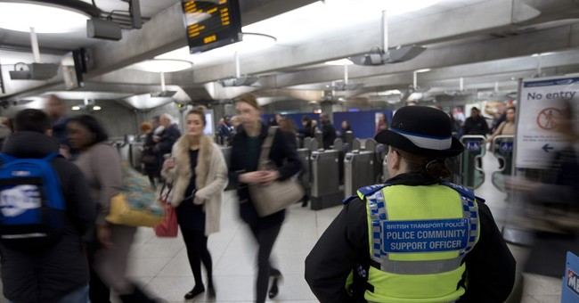 Man in court over London Tube attack; police step up patrols