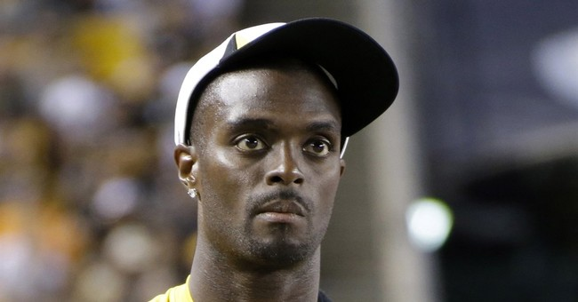 Former NFL star Plaxico Burress pleads guilty to tax evasion
