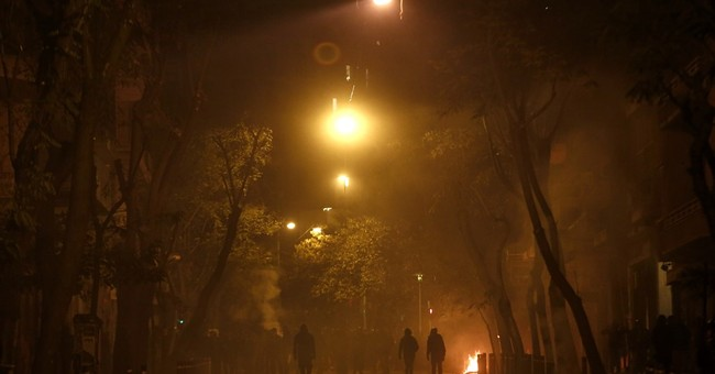 Greek police arrest 13 for overnight Athens riots