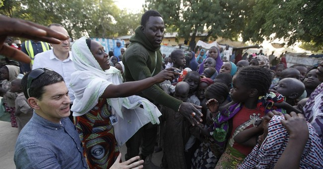 Refugee kids bring David Miliband to his knees in Nigeria