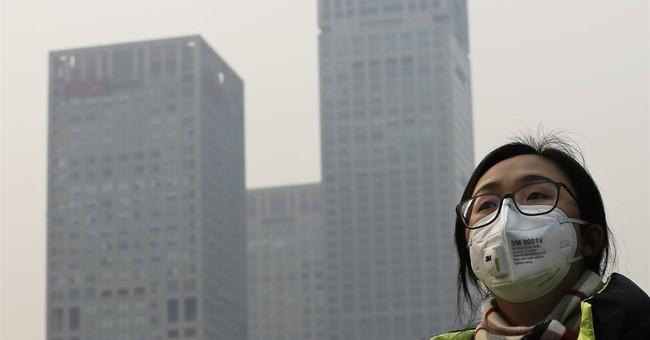 Beijing's smog crisis idles factories, boosts travel
