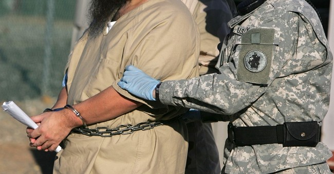 Officer backs use of female guards at Guantanamo's Camp 7