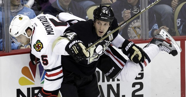 Family of late Blackhawks player Montador sues NHL