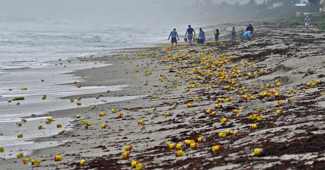 Hundreds of full coffee cans wash up on Florida beach