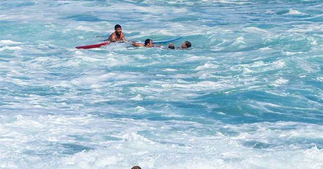 Bodyboarder rescues surfer at Hawaii's Pipeline surf spot
