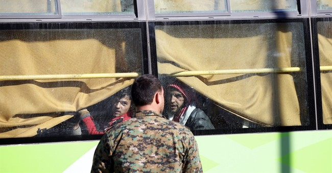 Amid a local truce, Syrians leave rebel-held area in Homs