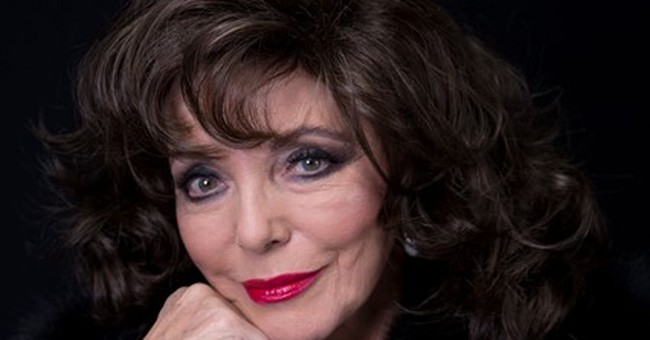 Joan Collins says Christmas bittersweet without Jackie