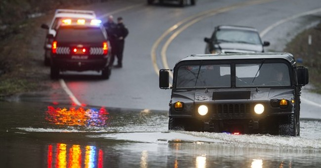 1 killed by tree; storms drench Pacific Northwest