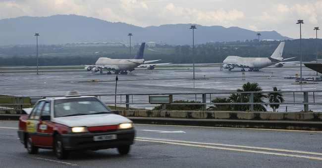 Malaysia cargo firm says it owns 3 jets left idle at airport