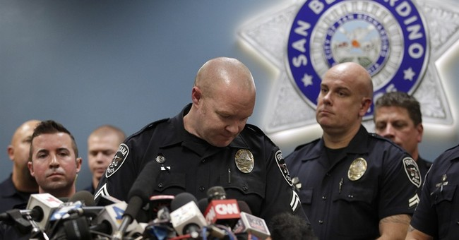 The Latest: California shooter, man who bought guns related
